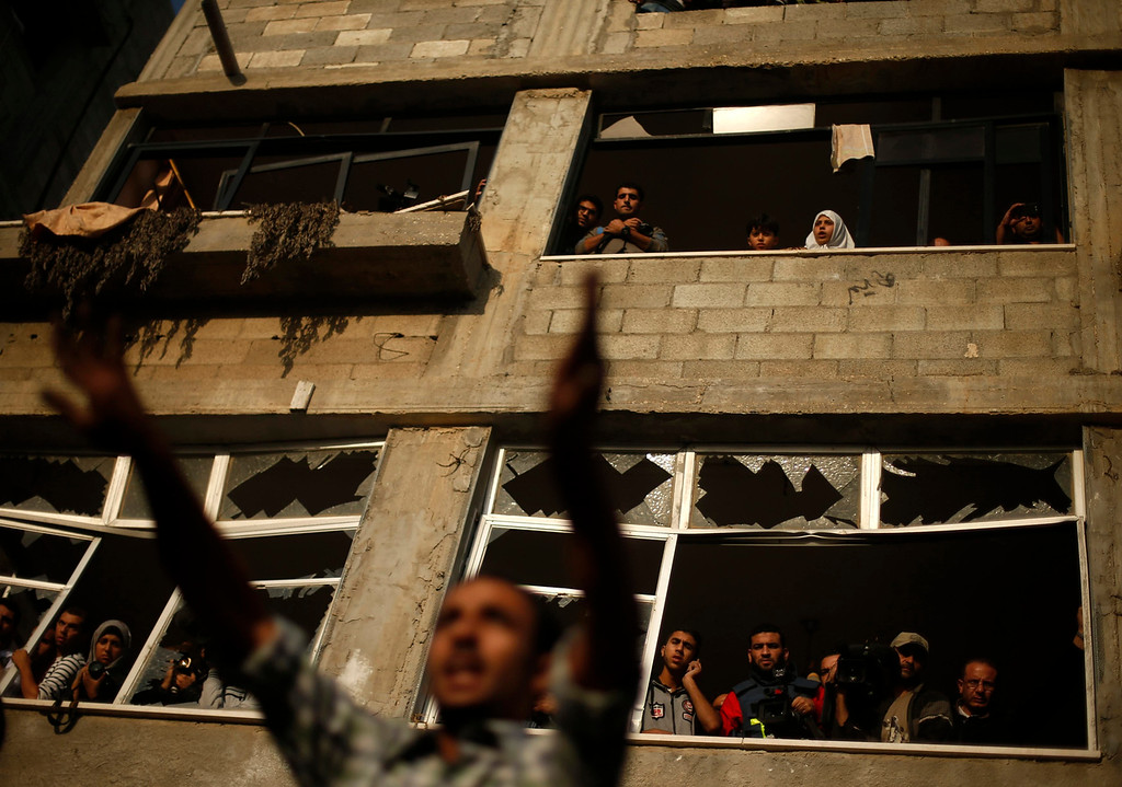 . A Palestinian man reacts at the scene of an Israeli air strike on a house in Gaza City November 18, 2012. Ten Palestinian civilians were killed on Sunday in an Israeli air strike on a house in Gaza, Palestinian medics said, the highest civilian death toll in a single incident during five days of fighting.  REUTERS/Suhaib Salem