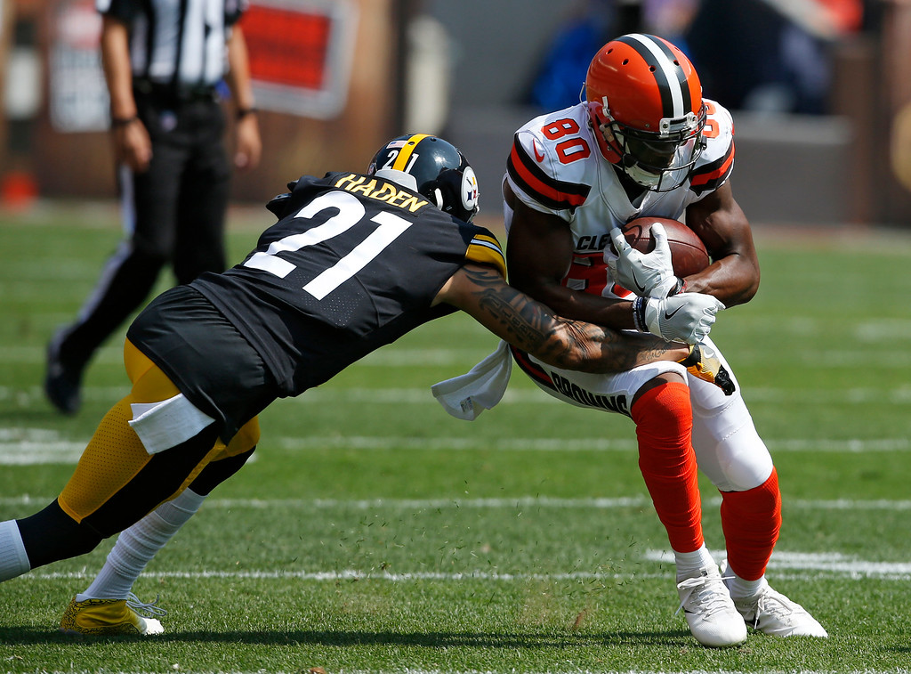 . Cleveland Browns wide receiver Ricardo Louis (80) is tackled by Pittsburgh Steelers cornerback Joe Haden (21) during the first half of an NFL football game, Sunday, Sept. 10, 2017, in Cleveland. (AP Photo/Ron Schwane)
