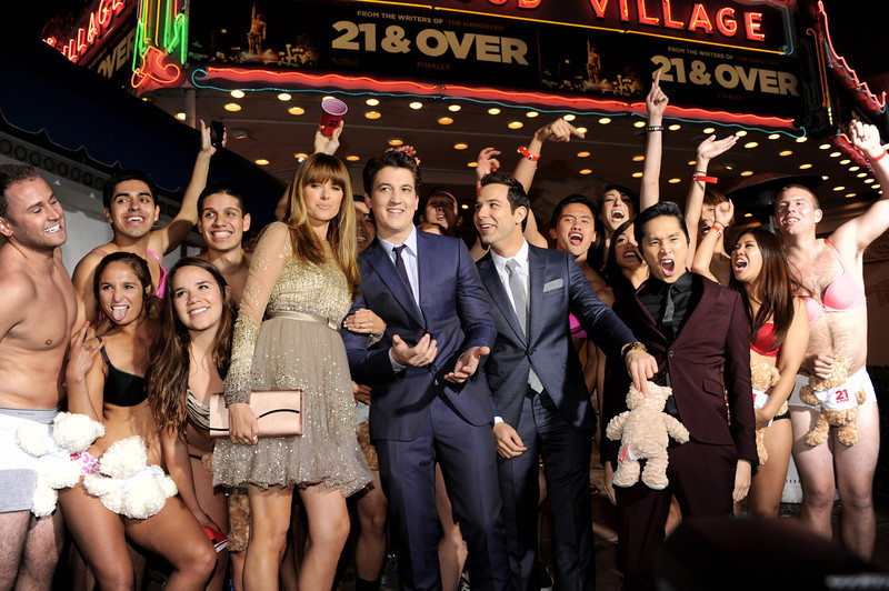 """. Actors Sarah Wright, Miles Teller, Skylar Astin and Justin Chon pose at the premiere of Relativity Media\'s \""""21 And Over\"""" at the Village Theatre on February 21, 2013 in Los Angeles, California.  (Photo by Kevin Winter/Getty Images)"""