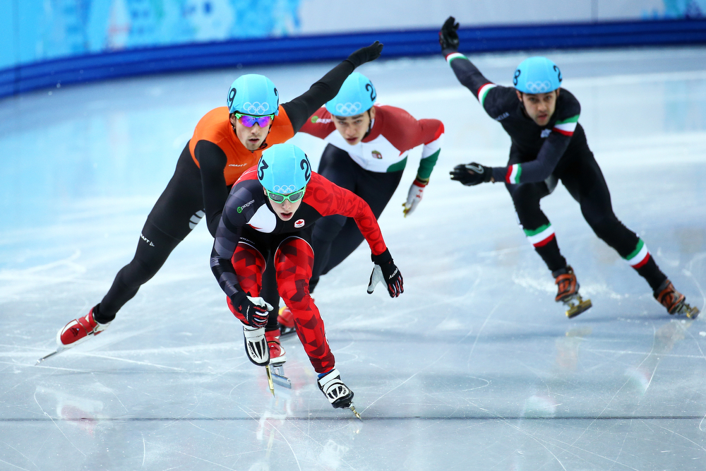 . Charle Cournoyer of Canada leads the pack in the Short Track Men\'s 500m Heat at Iceberg Skating Palace on day 11 of the 2014 Sochi Winter Olympics on February 18, 2014 in Sochi, Russia.  (Photo by Streeter Lecka/Getty Images)