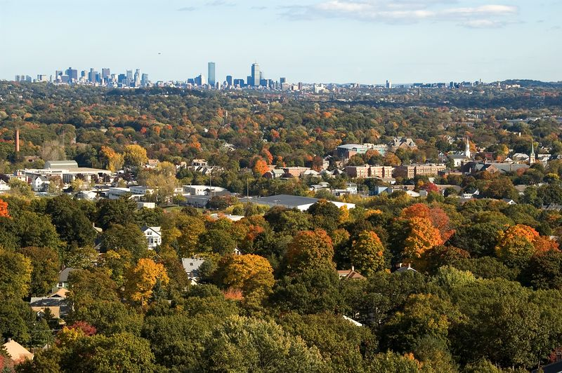 Boston skyline and fall colors of Eastern Mass   (Oct 18, 2004, 2:41pm)  On the eastern edge of the Prospect Hill Park is a tall cliff with no less than three different overlooks of Boston.  This is a picture of Boston from the middle overlook showing both the Boston skyline and the foliage colors of the towns of Waltham, Watertown and Cambridge.