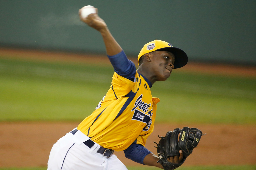 . Chicago\'s Marquis Jackson delivers during the first inning of an elimination baseball game against Philadelphia at the Little League World Series tournament in South Williamsport, Pa., Thursday, Aug. 21, 2014. (AP Photo/Gene J. Puskar)