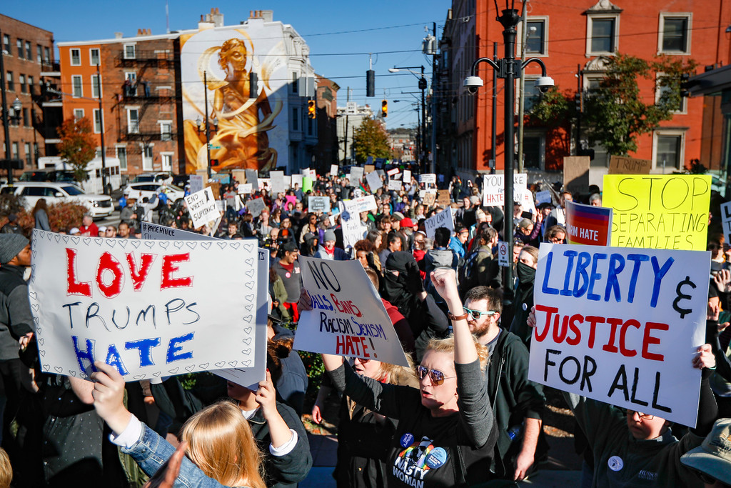 . Protestors, some carrying anti-Trump signs, march through downtown after a mistrial was declared due to a hung jury in the murder trial against Ray Tensing, Saturday, Nov. 12, 2016, in Cincinnati. Tensing, a white former University of Cincinnati police officer, was charged with murder in the shooting of Sam DuBose, an unarmed black motorist, while on duty during a routine traffic stop on July 19, 2015. (AP Photo/John Minchillo)