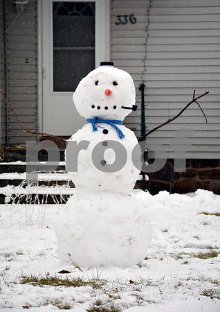 1/17/2018 Mike Orazzi   Staff A snowman along Redstone Hill Road in Bristol during Wednesday's storm.