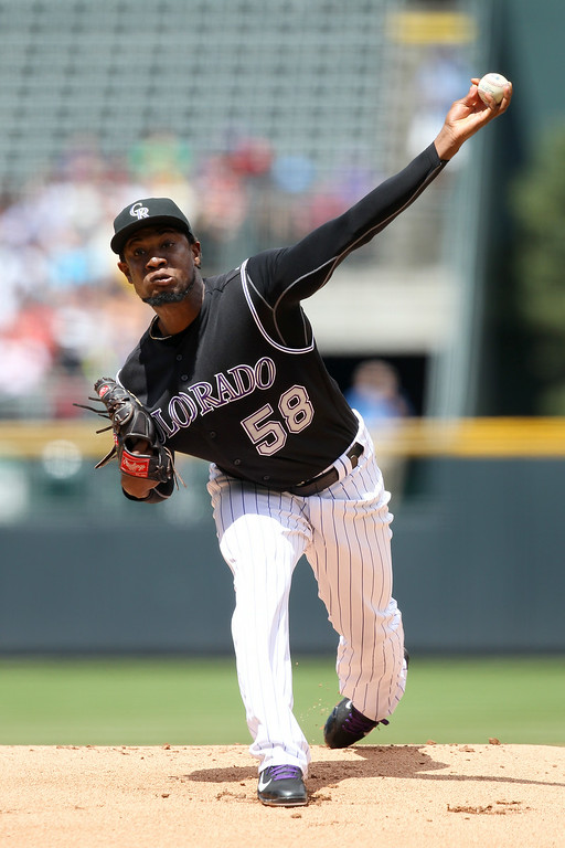 . Yohan Flande #58 of the Colorado Rockies delivers a pitch in the first inning against the Chicago Cubs at Coors Field on August 7, 2014 in Denver, Colorado. (Photo by Trevor Brown, Jr./Getty Images)