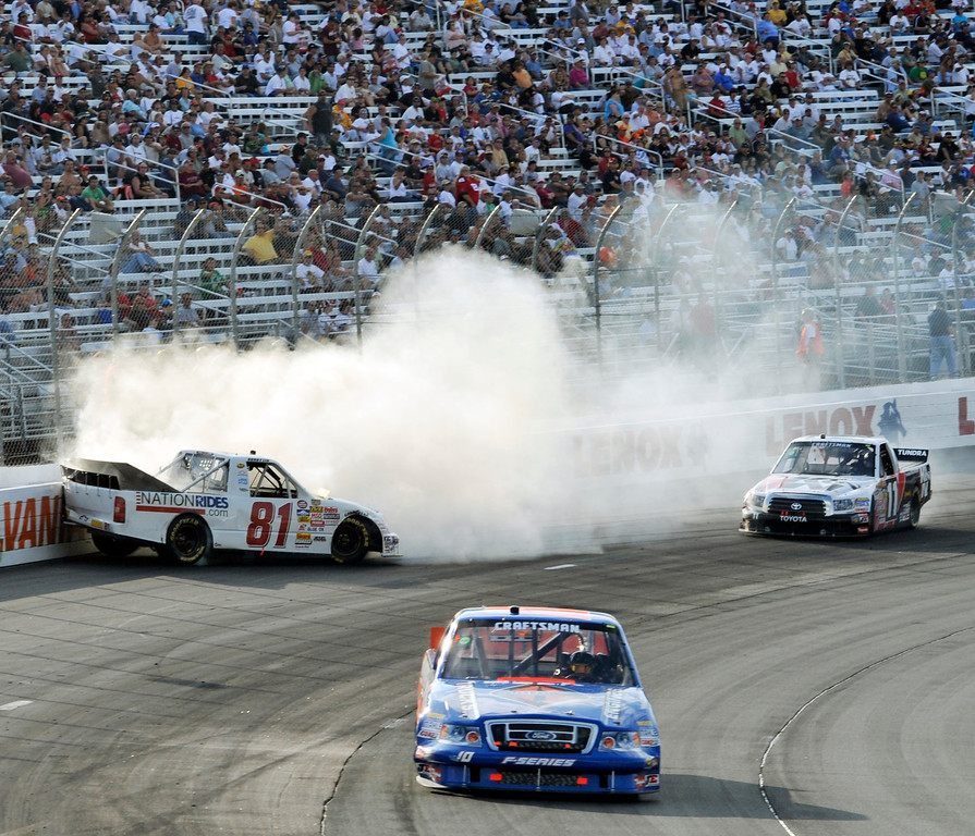 . Donny Lia (81) crashes into the wall during the NASCAR Craftsman Truck Series\' New Hampshire 200 auto race at New Hampshire Motor Speedway in Loudon, N.H., Saturday, Sept. 13, 2008. Ron Hornaday Jr. won the race. (AP Photo/Mike Silverwood)