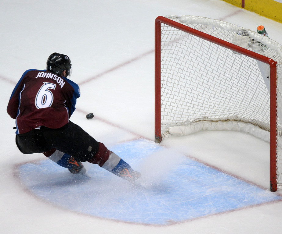 . Erik Johnson (6) of the Colorado Avalanche saves the puck from the empty net against the Minnesota Wild during the third period. The Colorado Avalanche hosted the Minnesota Wild during the first round of the NHL Stanley Cup Playoffs at the Pepsi Center on Thursday, April 17, 2014. (Photo by Karl Gehring/The Denver Post)