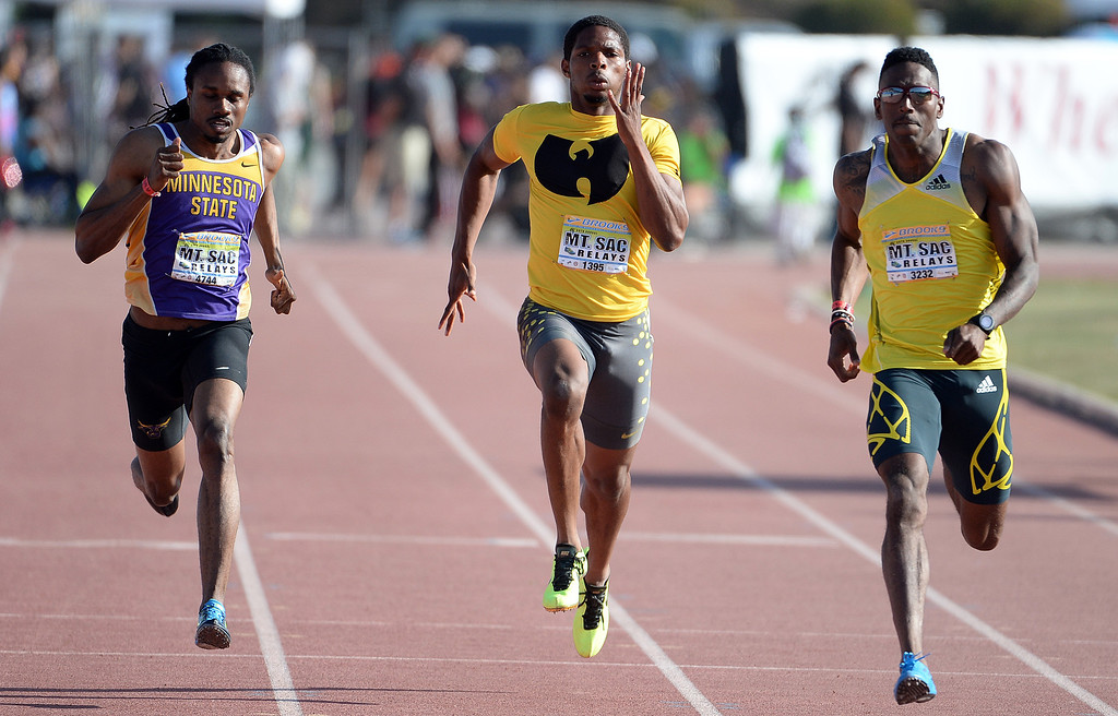 . Remontay McClain, center, competes in the 200 meter Dash Invitational Elite during the Mt. SAC Relays in Hilmer Lodge Stadium on the campus of Mt. San Antonio College in Walnut, Calif., on Saturday, April 19, 2014. 