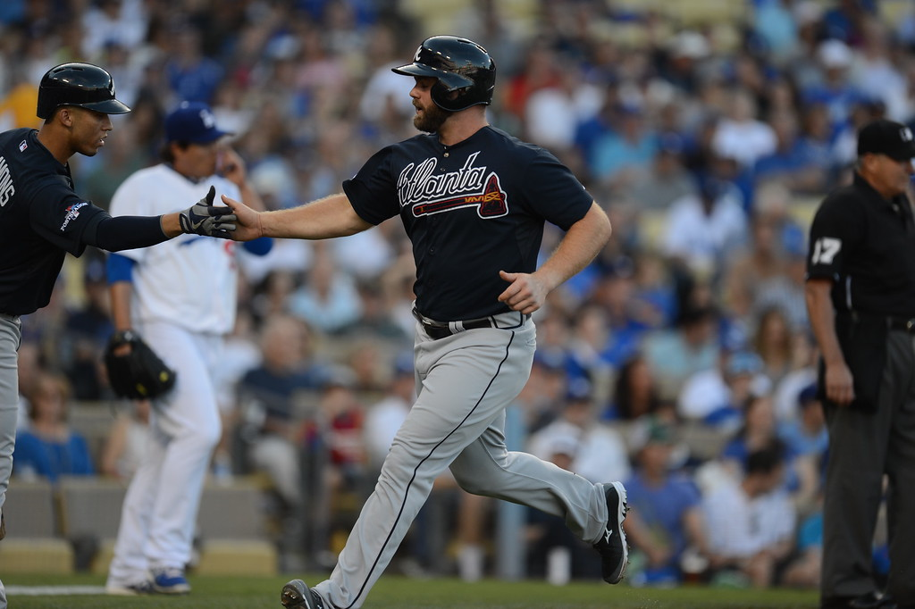 . The Brave\'s Evan Gattis scores in the first inning during game 3 of the NLDS at Dodger Stadium Sunday, October 6, 2013. (Photo by Hans Gutknecht/Los Angeles Daily News)