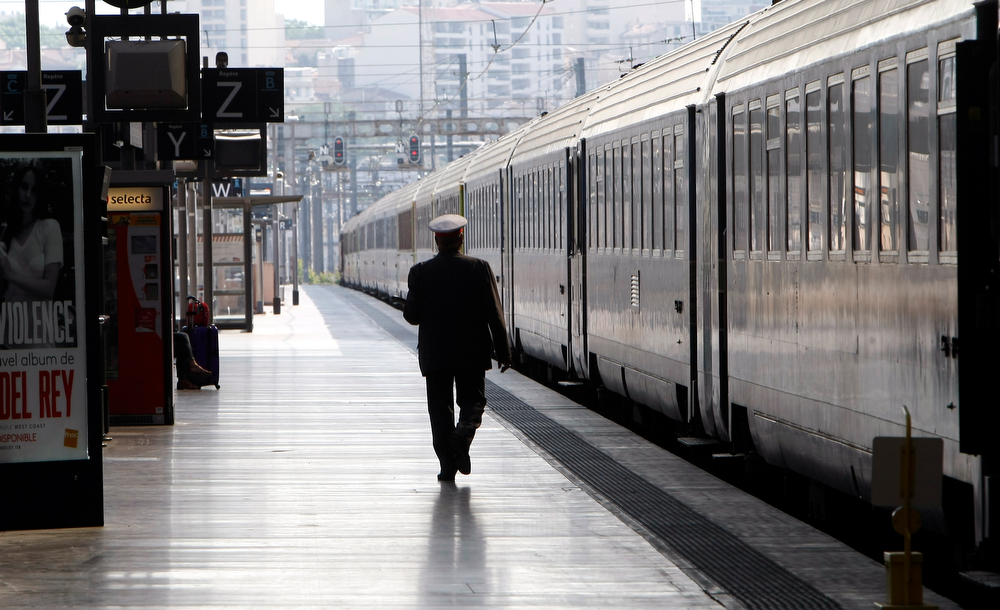 Description of . An employee of French national railway SNCF walks on a platform  at Saint-Charles railway station, in Marseille, southern France, Tuesday, June 17, 2014. A weeklong strike by rail workers has caused one of the worst disruptions to the country's rail network in years _ and is heating up as the reform bill goes to the lower house of Parliament for debate Tuesday. The bill would unite the SNCF train operator with the RFF railway network, which would pave the way to opening up railways to competition. Workers fear the reform will mean job losses and security concerns. The government says the reform is needed to create a stronger structure for the railways, as France and other European countries gear up for full-scale railway liberalization in coming years. (AP Photo/Claude Paris)