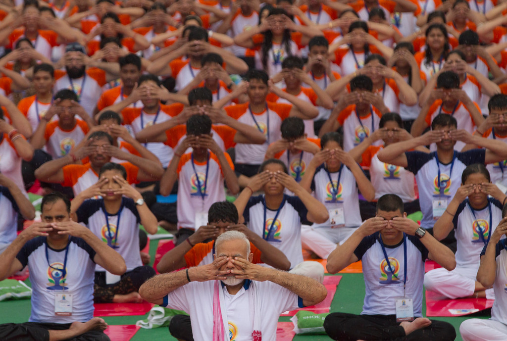 . Indian Prime Minister Narendra Modi, foreground center, performs yoga with thousands of Indians to mark international yoga day in Lucknow, India, Wednesday, June 21, 2017. Millions of yoga enthusiasts across India take part in a mass yoga sessions to mark the third International Yoga Day which falls on June 21 every year. (AP Photo/Rajesh Kumar Singh)