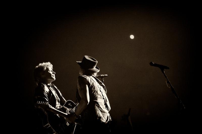 . March 13, 2013 - Bon Jovi members Jon Bon Jovi, left, and Richie Sambora perform on stage at the Scottrade Center in St. Louis, MO on March 13, 2013.  (Photo credit: David Bergman / Bon Jovi)