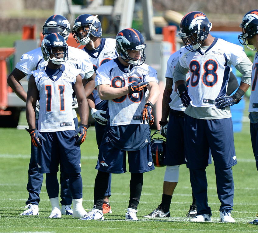 . Denver Broncos wide receivers Trindon Holliday (11) Wes Welker (83) Demaryius Thomas (88) and Erick Decker (87) look on during the teams OTAs May 20, 2013 at Dove Valley. All offseason training activities (OTAs) are voluntary until the mandatory minicamp June 11-13. (Photo By John Leyba/The Denver Post)