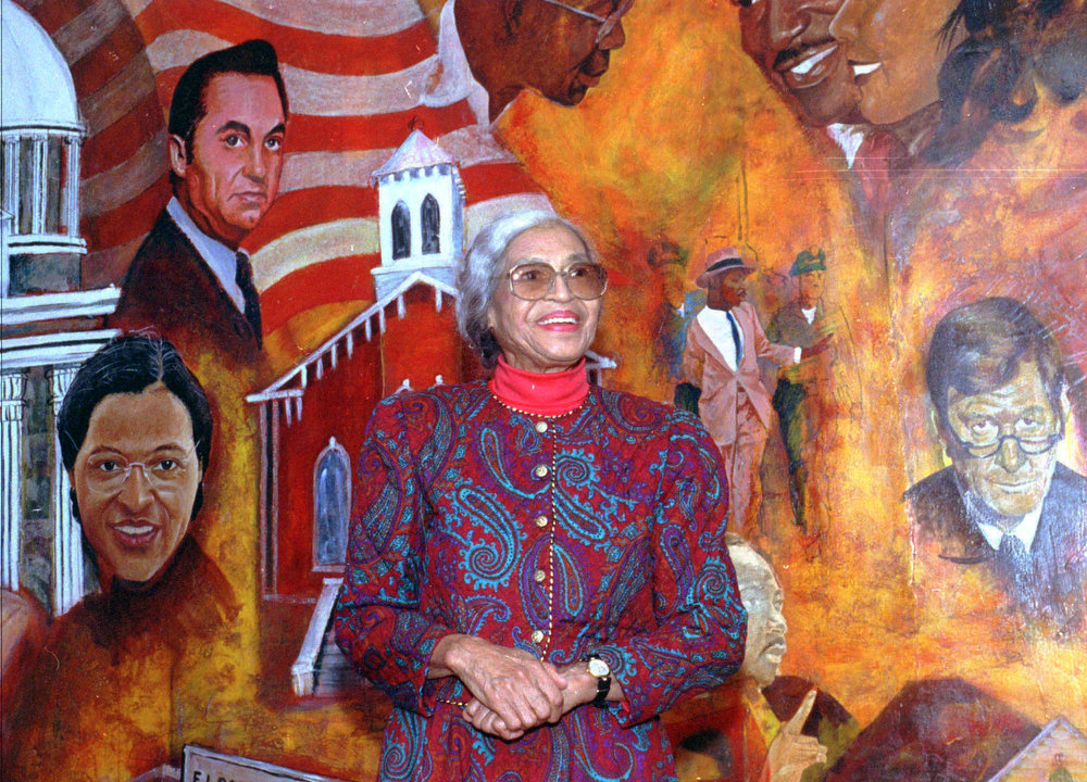Description of . This is a Nov 21, 1992 photo of civil rights pioneer Rosa Parks pictured in front of a mural at the Dexter Avenue King Memorial Baptist Church in Montgomery, Ala. Friday, Dec. 1, 1995 is the 40th anniversary of Park's arrest for refusing to give up her seat on a bus to a white person. (AP Photo)