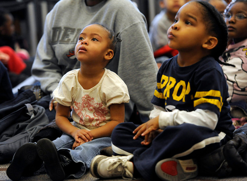 . Nyimah Bryant, left, and Khalil Mohammed, 4, from Real Kids Preschool listen as Denver singer Hazel Miller joins local pre-school and kindergarten children at the Blair Caldwell Library on Friday, Feb. 10, 2012 to help celebrate Black History Month by reading several books and singing a few songs. Clifford the Big Red Dog and Winnie the Pooh were also there to entertain the kids. Kathryn Scott Osler, The Denver Post
