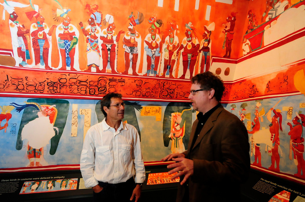 ". Archaeologist  Dr. Jaime Awe, left, and Ed Fleming, Curator of Archaelology at the Science Museum, talk in the ""Temple of the Murals\"" at the \""Maya: Hidden Worlds Revealed\"" exhibit at the Science Museum of Minnesota. (Pioneer Press: Scott Takushi)"