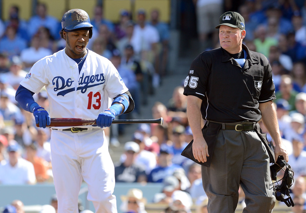. The Dodgers\' Hanley Ramirez argues with homeplate umpire Ted Barrett after being called out on strikes in the 1st inning against the Cardinals during game 5 of the NLCS at Dodger Stadium Wednesday, October 16, 2013.(David Crane/Los Angeles Daily News)