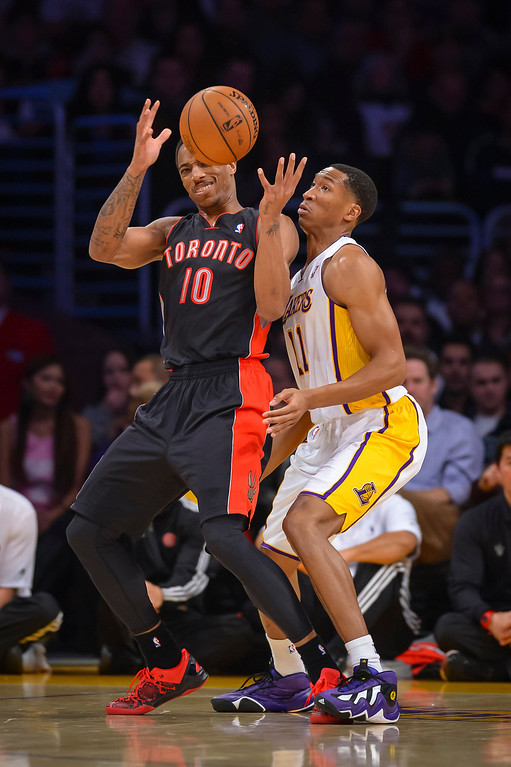 . Lakers� Wesley Johnson and Raptors� DeMar DeRozan go for a rebound during first half action at Staples Center Sunday, December 8, 2013.   ( Photo by David Crane/Los Angeles Daily News )