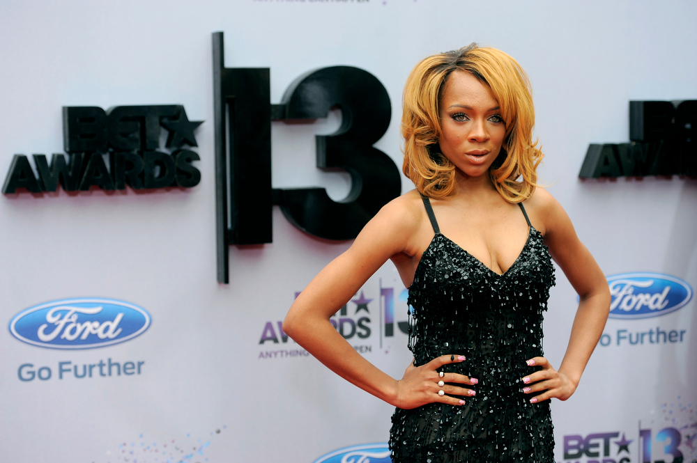 Description of . Lil' Mama arrives at the BET Awards at the Nokia Theatre on Sunday, June 30, 2013, in Los Angeles. (Photo by Chris Pizzello/Invision/AP)