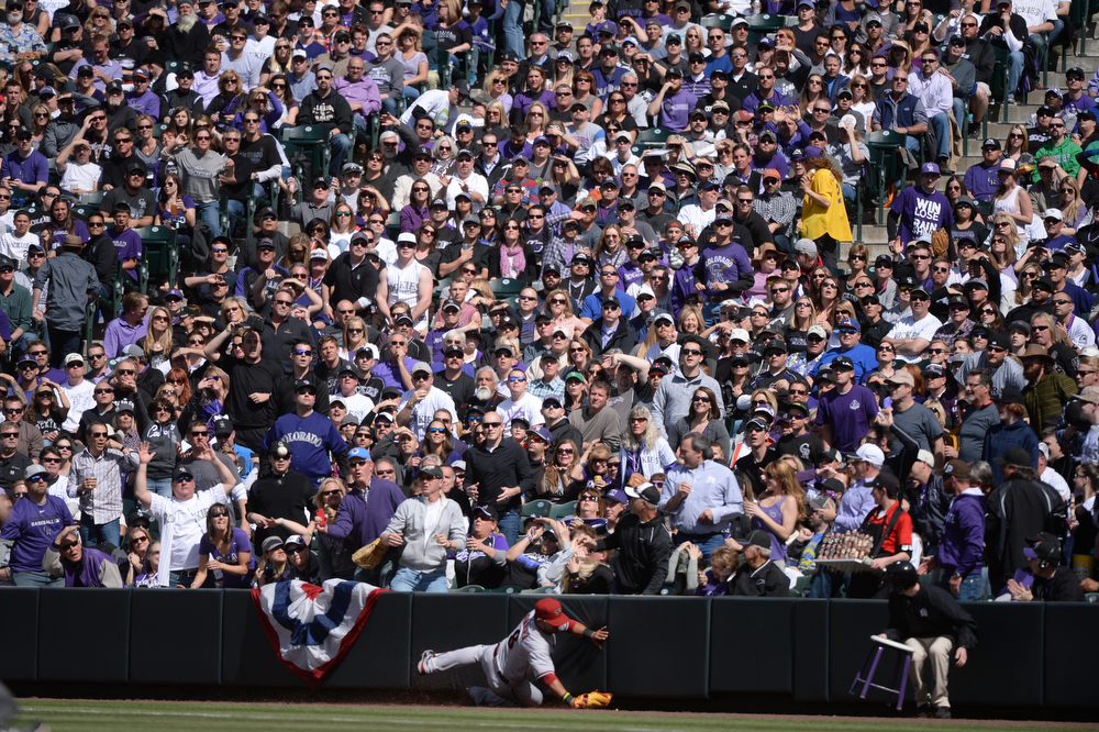 . DENVER, CO. - APRIL 4: Rockies fans watch for a foul ball hit by Michael Cuddyer. The Colorado Rockies hosted the Arizona Diamondbacks in the Rockies season home opener at Coors Field in Denver, Colorado Friday, April 4, 2014. (Photo by Karl Gehring/The Denver Post)