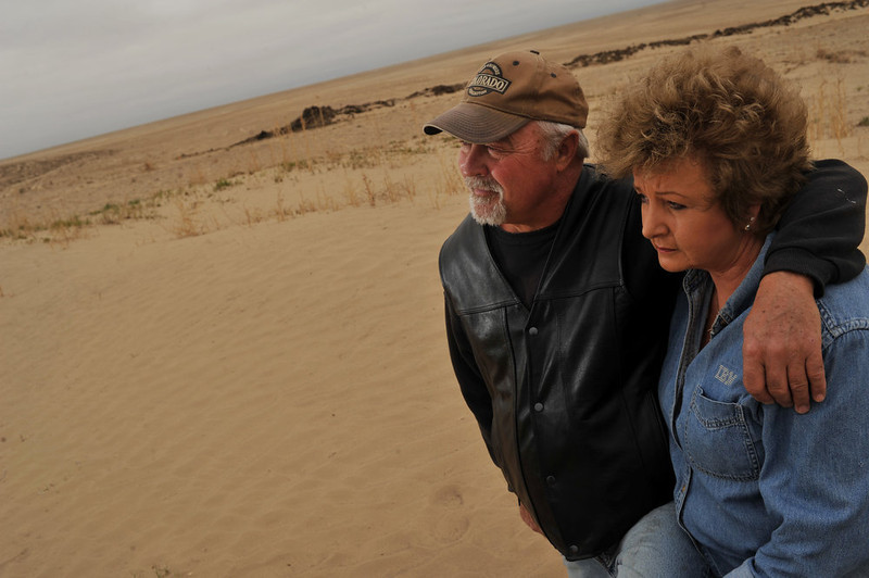 . David Tzilkowski, left, and his wife Jillane Hixson in their backyard in Lamar, Colorado on June 5, 2013. Their wheat crop was damaged by recent dust storms. (Photo By Hyoung Chang/The Denver Post)