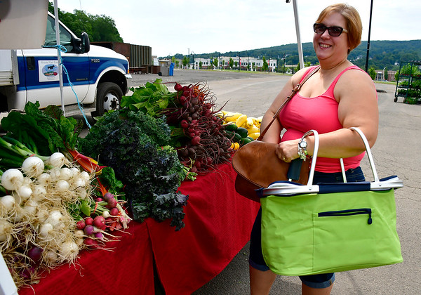 6/29/2019 Mike Orazzi | Staff Donna Klimkoski while shopping for fresh vegetables and fruits at the Bristol Farmer's Market in downtown on Saturday.