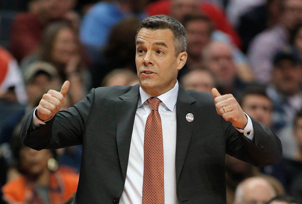 . Virginia coach Tony Bennett signals for a jump ball during the first half of the team\'s first-round game against UMBC in the NCAA men\'s college basketball tournament in Charlotte, N.C., Friday, March 16, 2018. (AP Photo/Bob Leverone)