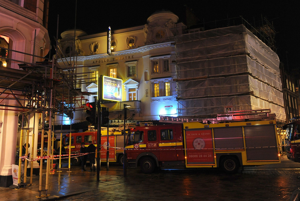 ". Emergency services attend the scene at the Apollo Theatre in Shaftesbury Avenue, central London, Thursday, Dec. 19, 2013. A theater in central London partially collapsed Thursday night during a performance at the height of the Christmas season, with police saying there were ""a number\"" of casualties. (AP Photo/PA, Dominic Lipinski)"