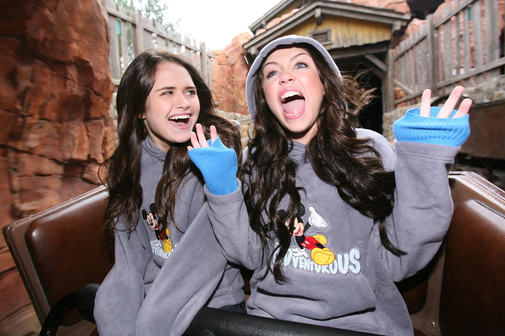 . In this image made available by Disney, Miley Cyrus, right, rides Big Thunder Mountain with her best friend Tory Sparkman at Disneyland Resort Paris Saturday, March 31, 2007, on the day the vacation resort officially launched its 15th anniversary celebration.  Cyrus, who will turn 15 during the resort\'s yearlong 15th anniversary celebration year, cut the ribbon to officially launch the event. (AP Photo/Disney, Liam Daniel)