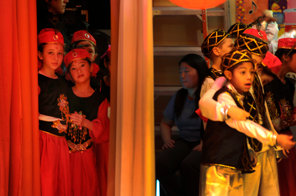 . Third-graders Alejandra Cole, 8, left, and Avery McLaughlin, 8, second from left, wait backstage with their classmates ready to perform the Xinjiang  (Uyghur ) Dance. Students at the Denver Language School ring in the Year of the Snake with their Chinese New Year celebration performance in the school auditorium. Kindergarteners through 4th grade perform traditional dances dressed in colorful Chinese costumes. According to the school principal, Chinese New Year is the most important of the traditional Chinese holidays. Families make way for  good luck by cleaning their homes symbolizing reconciliation and forgetting old grudges in exchange for peace and happiness. The Chinese New Year (Feb. 10) follows the Chinese 12 Zodiac Calendar Year designating 2013 the Year of the Snake. (Photo By Kathryn Scott Osler/The Denver Post)