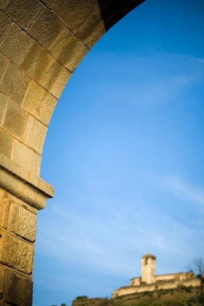 Alcantara bridge triumphal arch with Las Monjas convent on the background, town of Alcantara, province of Caceres, autonomous community of Extremadura, southwestern Spain