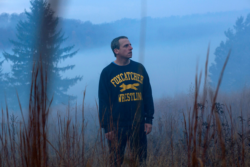 """. This image released by Sony Pictures Classics shows Steve Carell in a scene from \""""Foxcatcher.\""""Carell portrays John du Pont, a millionaire convicted of third-degree murder in the death of Dave Schultz, an Olympic champion freestyle wrestler. The film was nominated for a Golden Globe for best drama on Thursday, Dec. 11, 2014. The 72nd annual Golden Globe awards will air on NBC on Sunday, Jan. 11. (AP Photo/Sony Pictures Classics, Scott Garfield)"""
