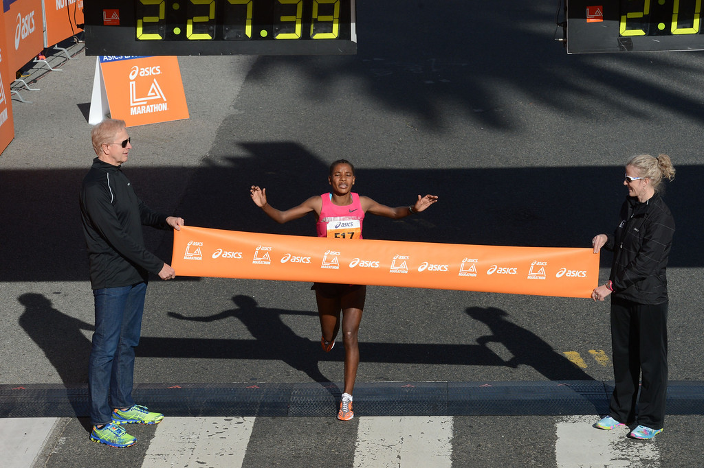 . 2014 ASICS LA Marathon women\'s winner Amane Gobena of Ethiopia,  crosses the finish line in Santa Monica Calif, with a time of 2: 27:37.   Sunday, March 9,  2014.   (Photo by Stephen Carr / Daily Breeze)