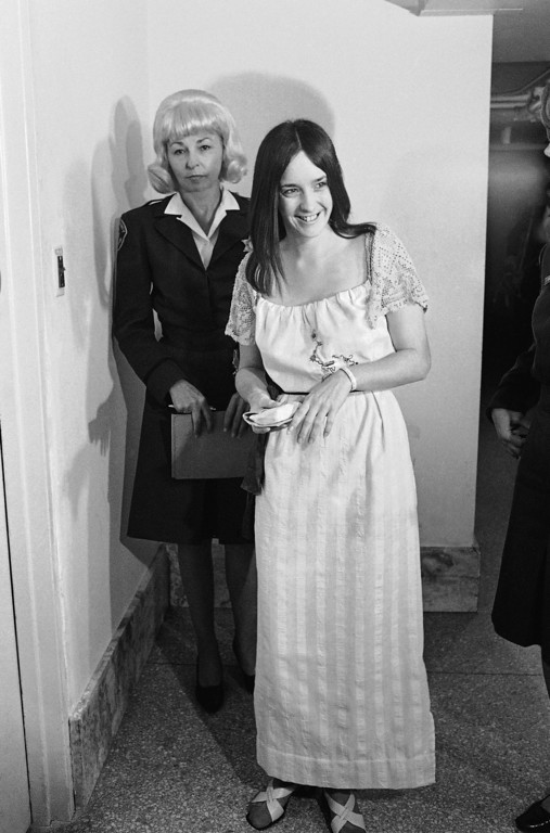 . Susan Denise Atkins, a devotee of the miniskirt in previous court appearances, wears a maxi length white cotton dress in Los Angeles for her arraignment on conspiracy and murder charges in the stabbing death of musician Gary Hinman, April 16, 1970.  She and cult leader Charles Manson are charged in the deaths of actress Sharon Tate and six others. (AP Photo/Wally Fong)