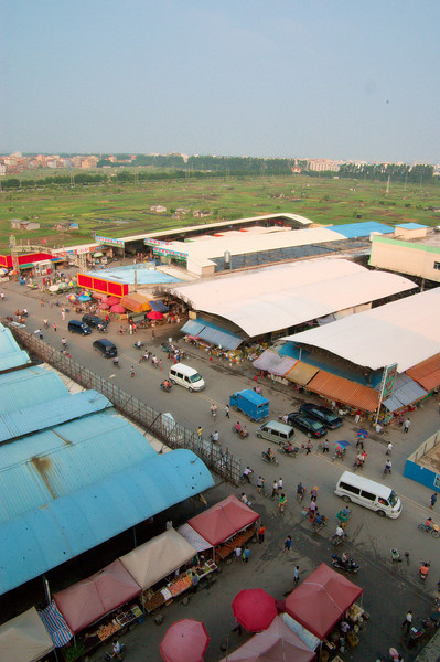 20090831_3117 Fresh produce markets as seen from my hotel window.   Due to a very late flight from Chengdu to Guangzhou, a mistake at the ticketing department at Guangzhou and my inability to communicate my predicament, I was unexpectedly stuck in Guangzhou for a few days, waiting for the next flight to Australia. They put me up in a hotel, which fortunately was right next to fruit market stalls (open from 7 a.m. to approx 11 p.m.)