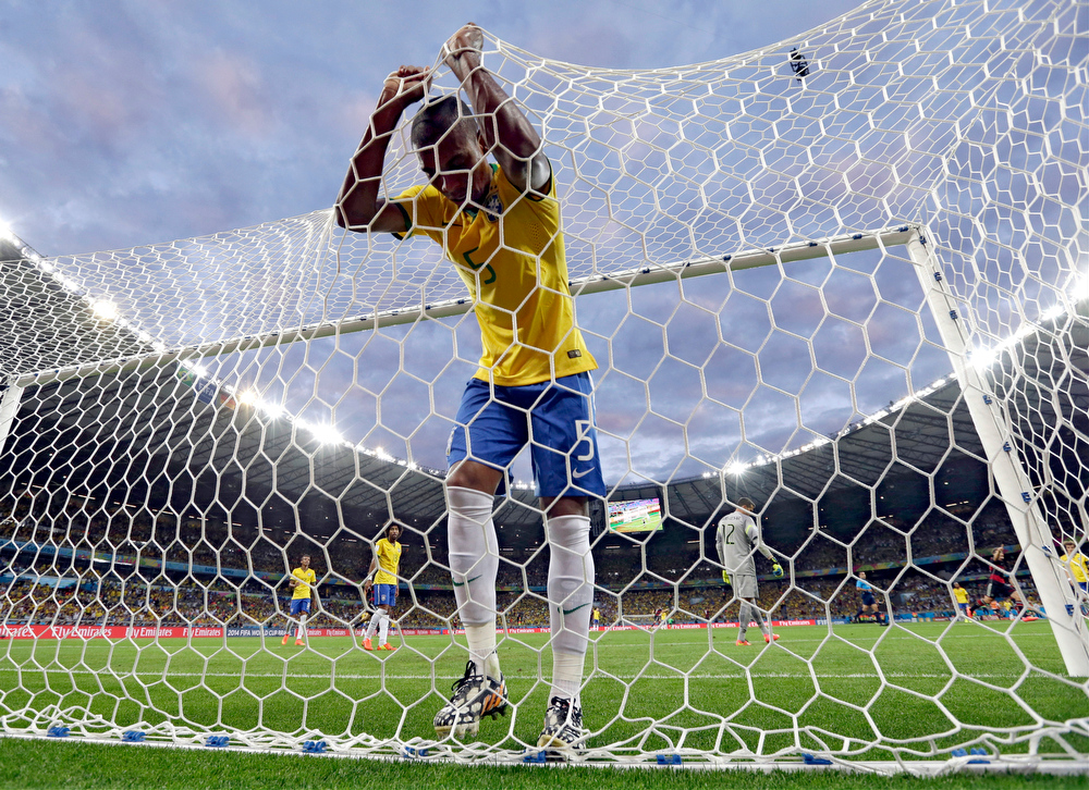 Description of . Brazil's Fernandinho reacts after Germany's Toni Kroosduring scored his side's third goal during the World Cup semifinal soccer match between Brazil and Germany at the Mineirao Stadium in Belo Horizonte, Brazil, Tuesday, July 8, 2014. (AP Photo/Natacha Pisarenko)