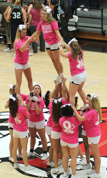 GWU cheerleaders wear pink to support breast cancer awareness.