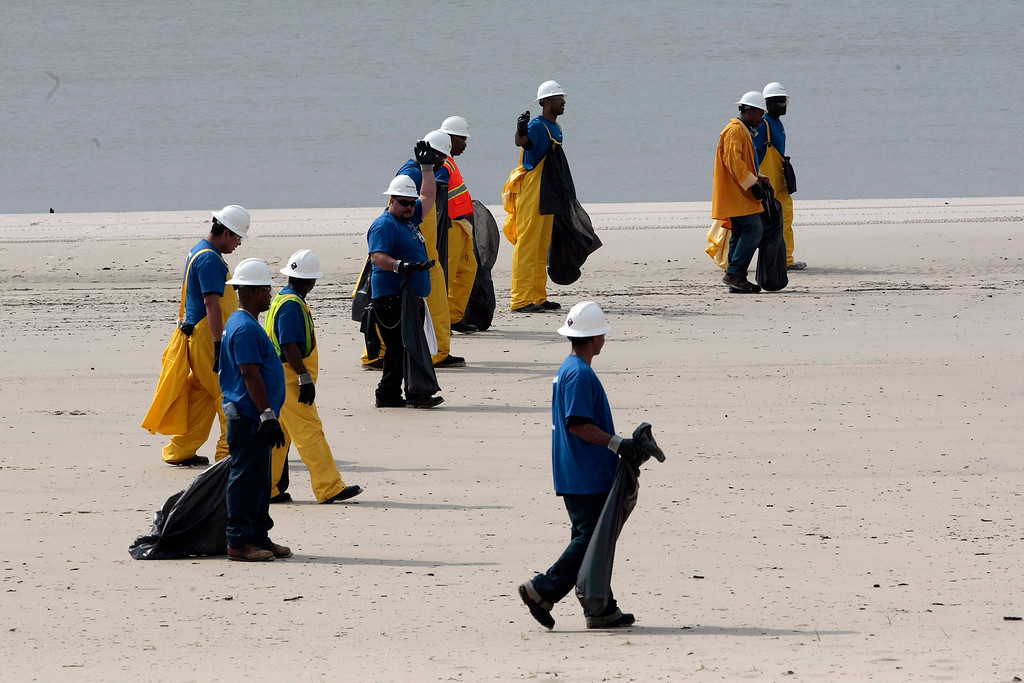 . Crews working along the beach look for debris including dead sea life that has washed ashore in Pass Christian, Miss., Monday, May 3, 2010. (AP Photo/Dave Martin)