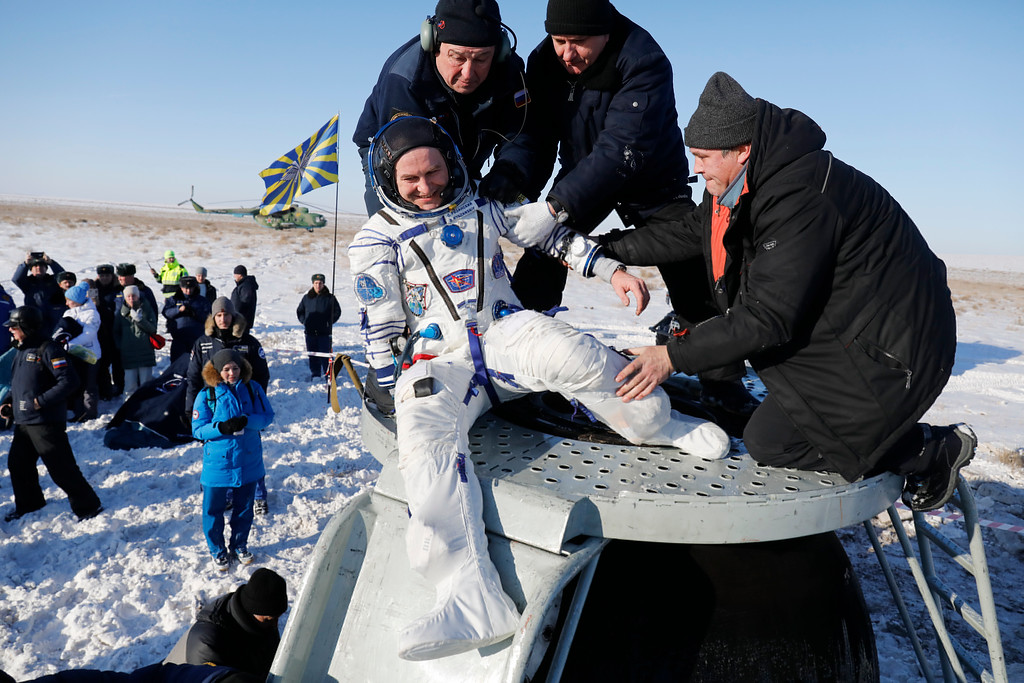 . Russian space agency specialists help Russian cosmonaut Sergey Ryazanskiy shortly after the landing of the Russian Soyuz MS-05 space capsule about 150 km ( 80 miles) south-east of the Kazakh town of Zhezkazgan, Kazakhstan, Thursday, Dec. 14, 2017. Three astronauts on Thursday landed back on Earth after nearly six months aboard the International Space Station. (AP Photo/Dmitri Lovetsky, Pool)
