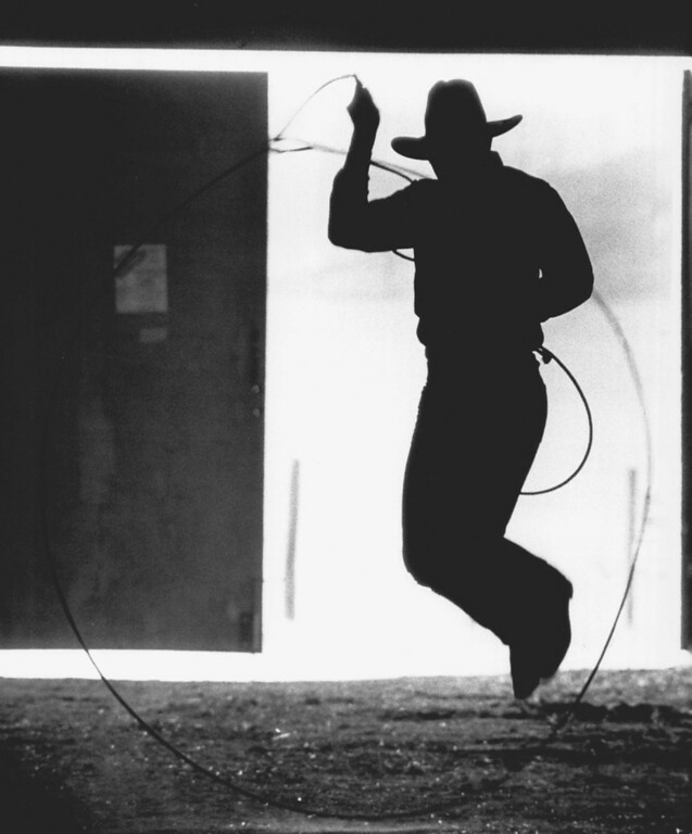. Jerry Diaz of San Antonio Tx practices his rope tricks for the National Western Stock Show. He is a National Champion in Charro and Trick roping. 1986. Jim Preston, The Denver Post