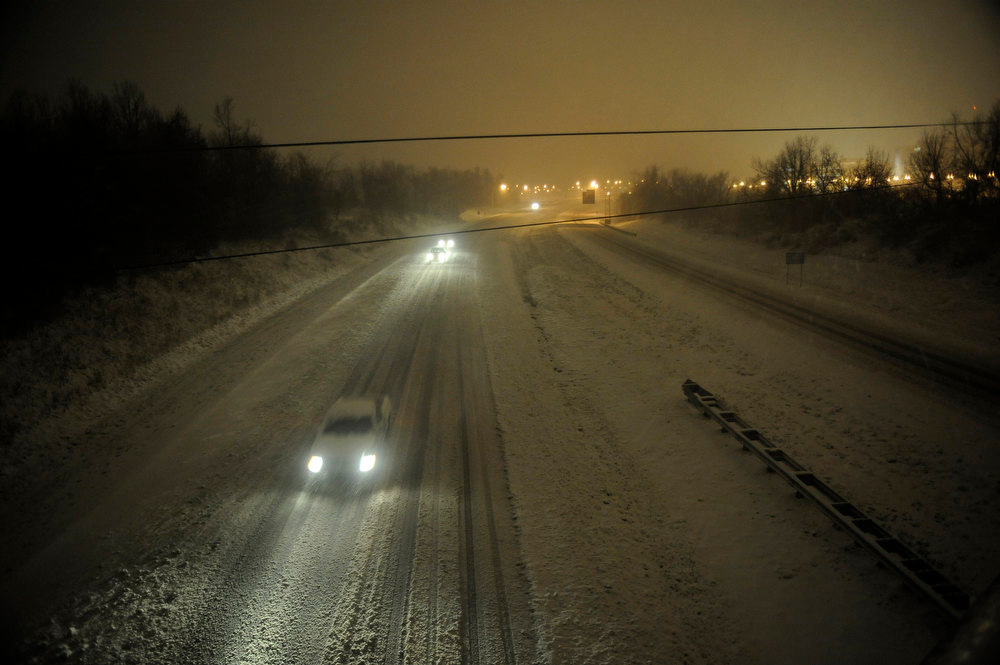 . Motorists travel slowly on a snow-covered Interstate 24 during a winter storm Wednesday, December 26, 2012, in Paducah, Ky. The storm dumped several inches of snow making travel hazardous. (AP Photo/Stephen Lance Dennee)