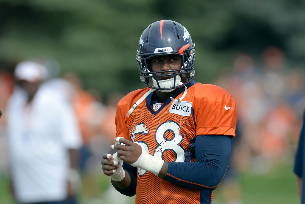 . Denver Broncos LB Von Miller tapes up his fingers during training camp August 1, 2013 at Dove Valley. (Photo By John Leyba/The Denver Post)