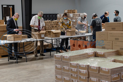 Rotary Clubs Volunteer at East Texas Food Bank by Sarah A. Miller