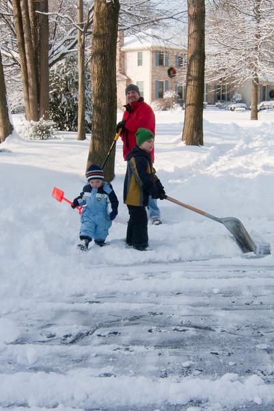 Team Kuhn shovels the driveway.