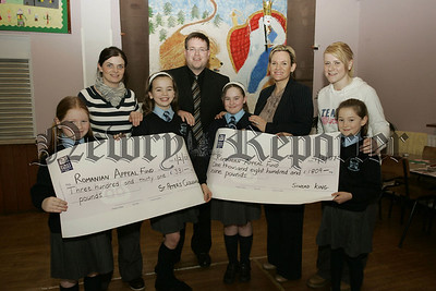 Pupils of St Peter's Cloughreagh, Dearbhla Wright, Aileen Kenny, Ellen kelly and Alisha Purcell present Sinead King from St paul's romania Project with a cheque for £331 the proceeds of their penny appeal.Sinead also recieved a cheque for £1809 proceeds of the Evening of Elegance held recently. Also pictured are Emmet McCaffery and Sinead O'Neill from St Paul's H.S. and Suzanne Burns Vice principal St Peter's Cloughreagh. 07W6N12