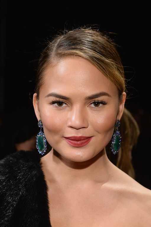 . Chrissy Teigen attends the Donna Karan New York 30th Anniversary fashion show during Mercedes-Benz Fashion Week Fall 2014 on February 10, 2014 in New York City.  (Photo by Larry Busacca/Getty Images for Mercedes-Benz Fashion Week)