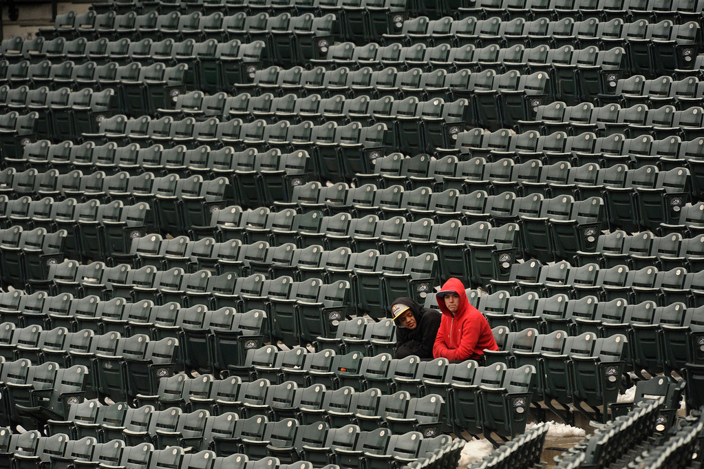 . A limited number of fans braved the cold for the game Tuesday. The Colorado Rockies hosted the New York Mets in a make up game Tuesday afternoon, April 16, 2013. Monday night\'s game was snowed out at Coors Field.  Photo By Karl Gehring/The Denver Post)