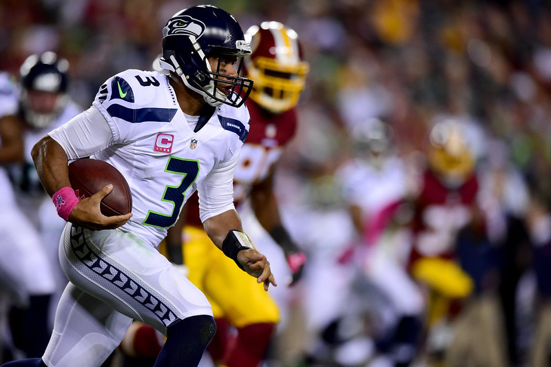 . Quarterback Russell Wilson #3 of the Seattle Seahawks rushes during the first half of a game against the Washington Redskins at FedExField on October 6, 2014 in Landover, Maryland.  (Photo by Patrick Smith/Getty Images)