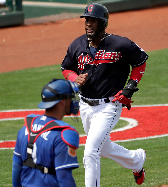 . Cleveland Indians\' Yandy Diaz scores on a base hit by Richie Shaffer during the first inning of a spring training baseball game, Monday, March 20, 2017, in Goodyear, Ariz., as Los Angeles Dodgers catcher Yasmani Grandal stands near the plate. (AP Photo/Matt York)