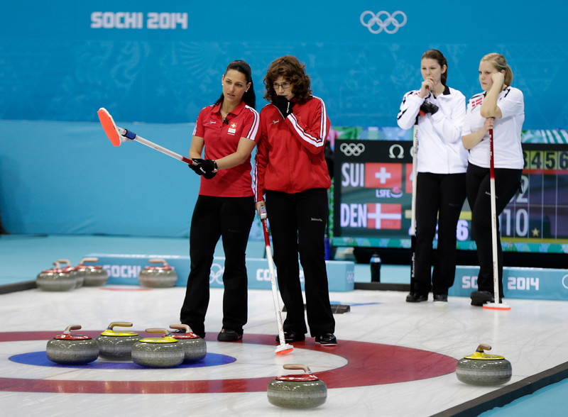 . Switzerland\'s Carmen Schaefer, left, and Mirjam Ott discuss their next shot during women\'s curling competition against Denmark at the 2014 Winter Olympics, Tuesday, Feb. 11, 2014, in Sochi, Russia. (AP Photo/Robert F. Bukaty)